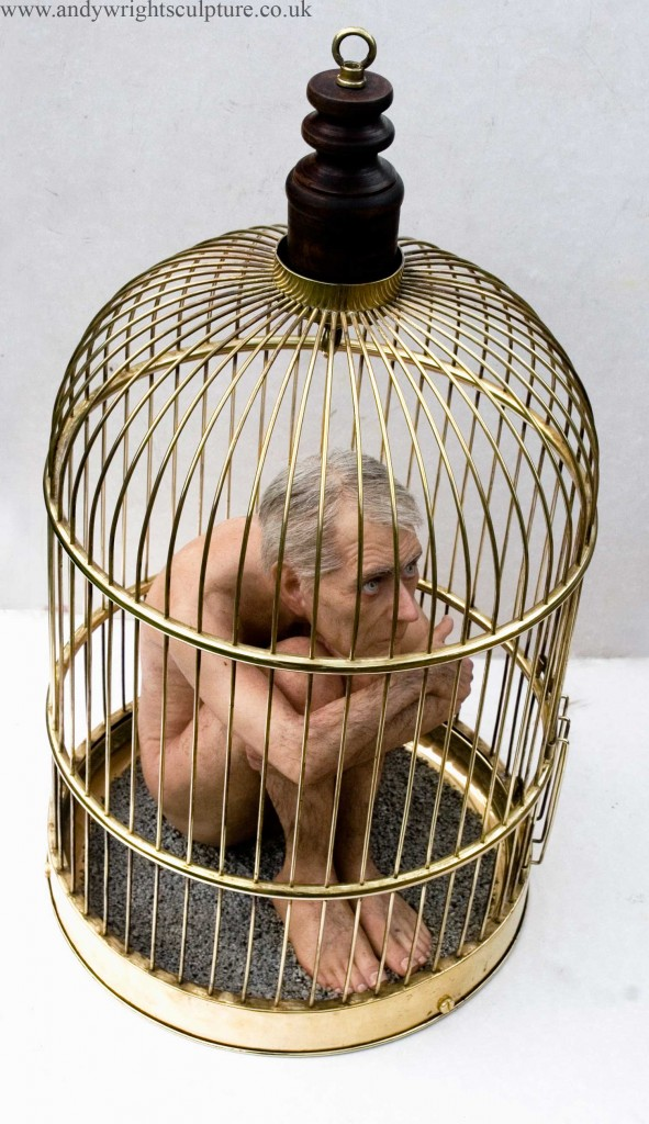 Caged nude middle age man - realistic miniature sculpture. Made from silicone, resin, acrylic, hair and brass cage