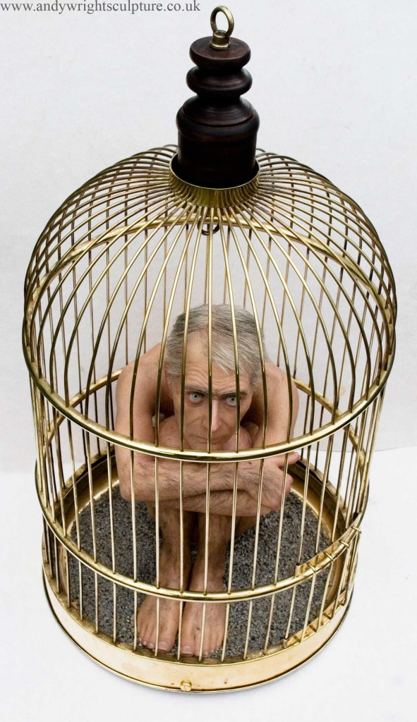 caged nude man looking through cage at the viewer trapped, hyper realsitic miniature sculpure made from silicone rubber, resin, acrylic, hair and brass cage