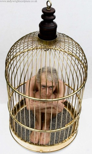 Man in cage, miniature fine art hyper real sculpture