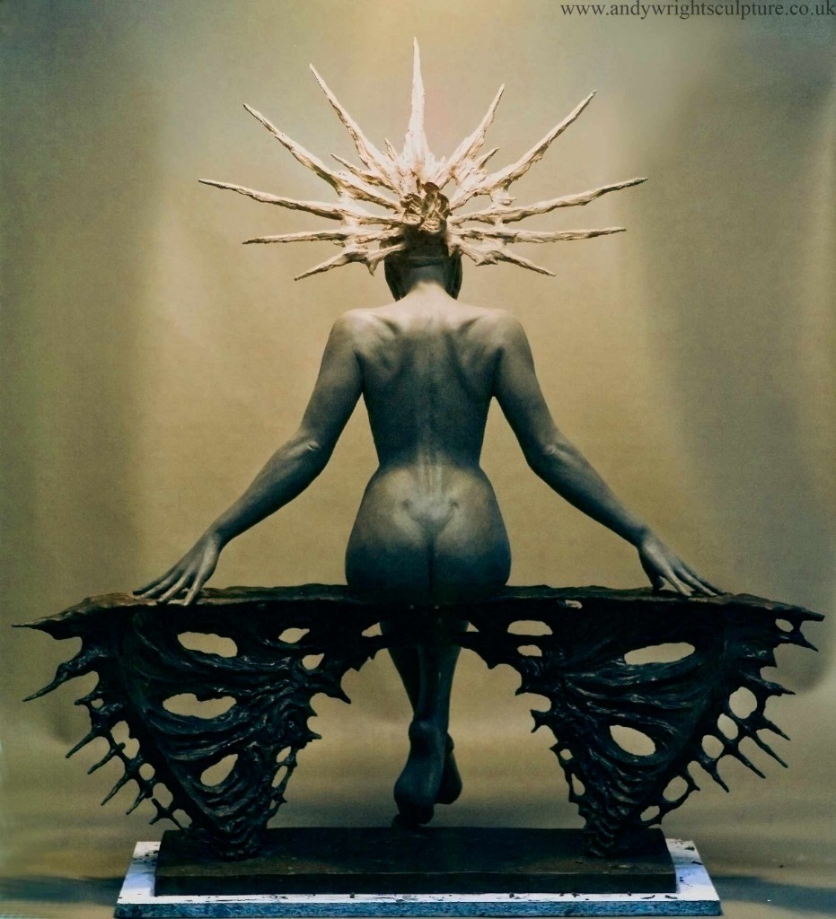 Female art nude statue wearing headdress, available in bronze